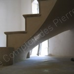 Staircase in Burgundy stone with the spirraling shape
