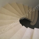 Staircase in Burgundy limestone with a spirraling shape