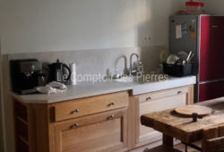 Custom-made Bastide sink <br/> and kitchen worktop <br/>Charmot light Honed finish