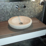 Custom-made washbasin in Burgundy limestone Charmot light Honed finish