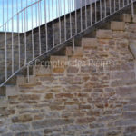 Solid staircase in Burgundy limestoneLanvignes Aged finish