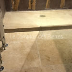 Paving in Lanvignes Vieux Beaune finish and shower tray in Burgundy limestoneLanvignes Aged finish
