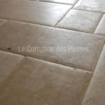 Tiling in Burgundy limestone Saint-Genay Honed finish with pillowed edges Opus VI 8 pieces