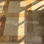 Paving Vieilles Dalles de Bourgognewith edging in oak wood